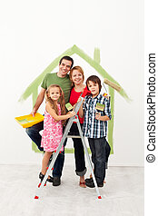 Happy family redecorating their home - Happy family with...