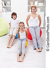Woman and kids exercising at home