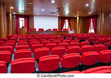 Conference centre with red armchairs