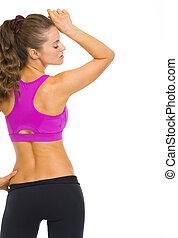 Fitness young woman rear view