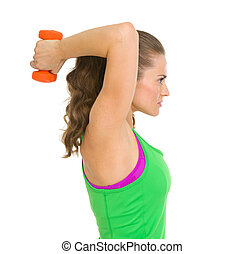 Fitness young woman making exercise with dumbbells