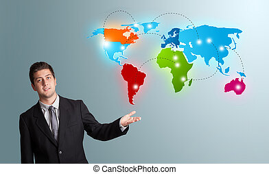 young man presenting colorful world map - handsome young man...