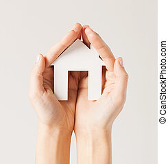 woman hands with paper house - pisture of woman hands...