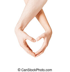 woman and man hands showing heart shape - close up of woman...