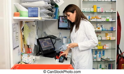 Female pharmacist working - Doctor working with medicine in...