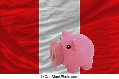 piggy rich bank and  national flag of peru