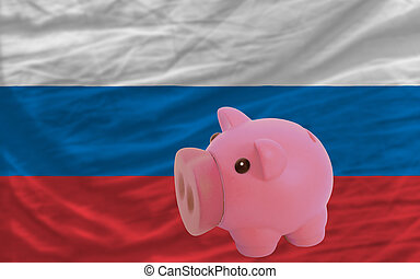 piggy rich bank and  national flag of russia