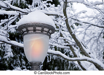 Lamplight in snow - Snowy scene with closeup on glowing...