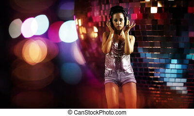 a sexy gogo dancer shot in a studio against green screen...