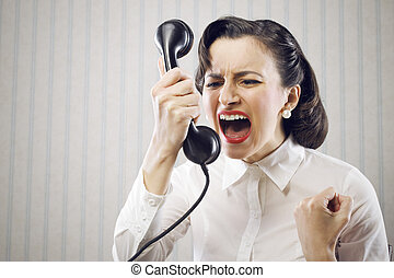 Young Woman shouting into telephone - Angry Business Woman...