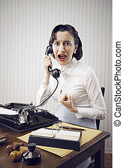 Work problems - Scared Young Woman shouting into telephone