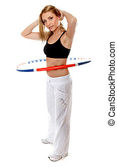 young fitness woman with hula hoop isolated - Full length...