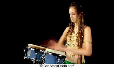 a female percussion drummer performing with bongos, shot as...