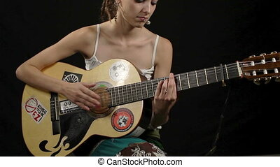 cool gypsy style woman plays guitar, including high quality...