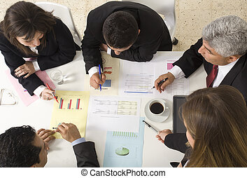 Businesspeople working together at meeting, discussing...