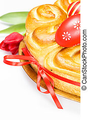 Easter bread with red eggs over white background