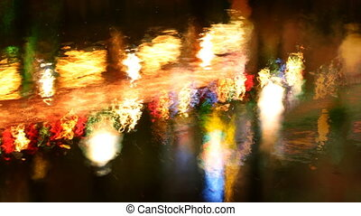 reflection in canal of red light district neon lights ,...