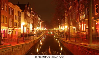 time-lapse shot of the red light district, amsterdam at...