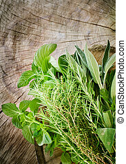 Fresh herbs - Fresh aromatic herbs on old wooden background