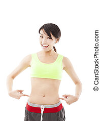 happy young woman doing exercise and point his waist