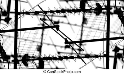 abstract pattern of tv aerials and satellites on rooftops