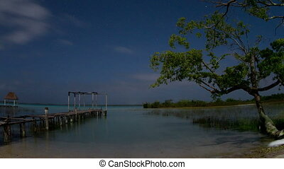 timelapse shot of the beautiful lake bacalar, at night with...