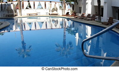 a luxury swimming pool in a boutique hotel