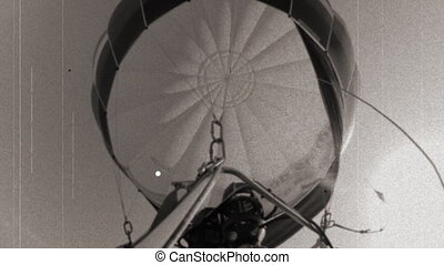 old film abstract version looking up into a hot air balloon during a ride