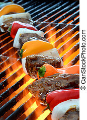 Kabob on Grill and Hot Flame - Meat and vegetable kabob on...