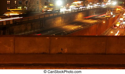 timelapse of traffic shot from brooklyn bridge at night, new...