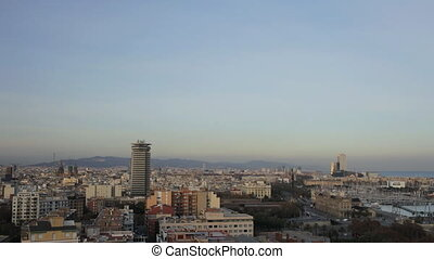 panoramic view of the city of barcelona at night, looking down from mont juic