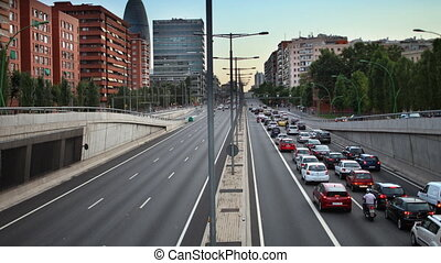 timelapse evening traffic shot from a bridge in barcelona spain