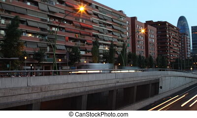 panning timelapse nighttime traffic shot from a bridge in barcelona spain