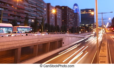 panning timelapse nighttime traffic shot from a bridge in...