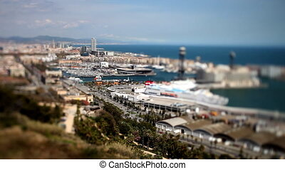 view of the city of barcelona, looking down from mont juic,with shallow depth of focus changing