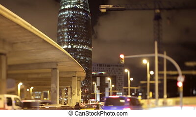 night shot of the torres agbar building in barcelona and...