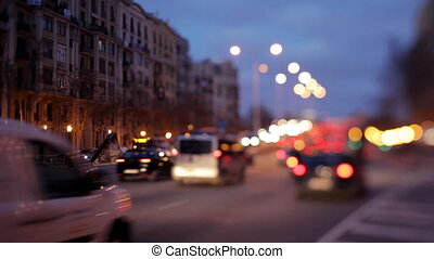 a night shot of a street scene in barcelona, spain using...