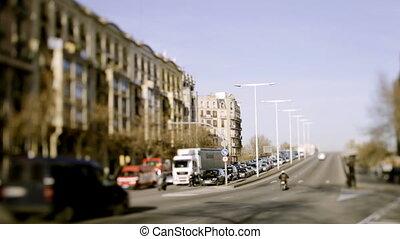 a timelapse of a street scene in barcelona, spain using tilt and shift lens