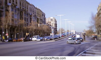 a shot of a street scene in barcelona, spain using tilt and...