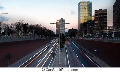 stop motion urban scene of traffic on a major road at dusk...
