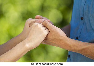 Lovers holding hands outdoors