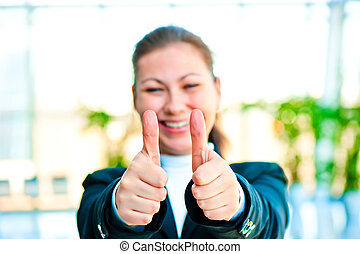 Girl in a business suit shows that everything is fine