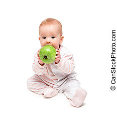 cute happy baby eats fruit green apple isolated on white...