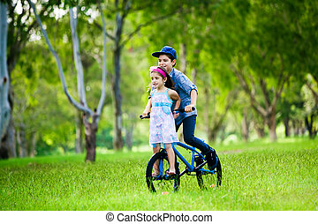 Brother taking his sister on a bike ride