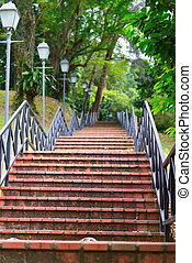 Modern stairs in a park - Red stone stairs on in a park with...