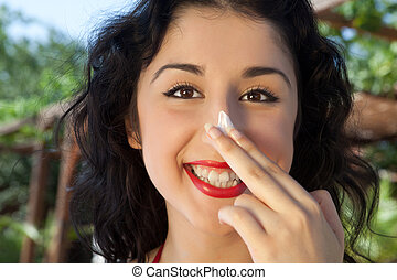 Sun protection on her nose - Happy young woman putting...