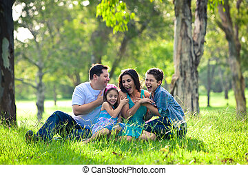Family laughing during picnic