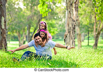 Father and daughters on picnic - flying in the air