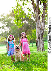 Two happy little girls and a golden retriever