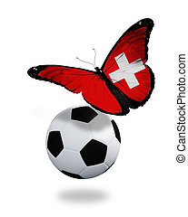 Concept - butterfly with Swiss flag flying near the ball,...